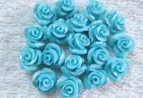 Synthetic blue turquoise flower carvings