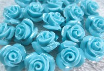 Synthetic turquoise carved flower beads